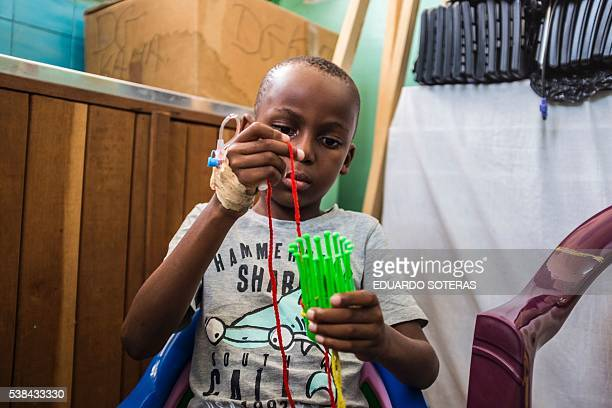Wilner an eight year old child that suffers from malaria plays at the Ngaliema Clinic in Kinshasa on April 14 2016 Have school classes at hospitals...