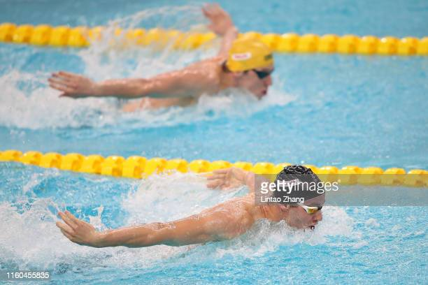 Wilrich Coetzee of New Zealand competes in the Men's 200m Butterfly with Nic Brown of Australia on day 2 of the 2019 FINA Swimming World Cup at Jinan...