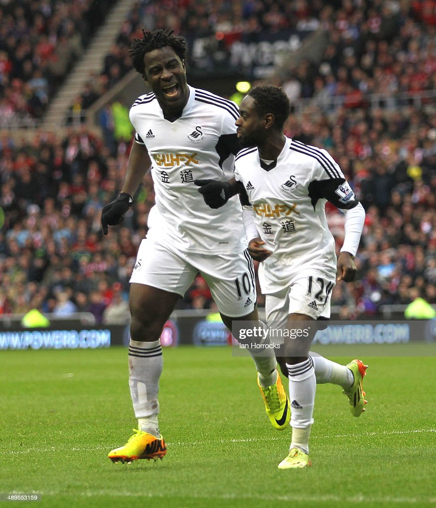 Wilried Bony (L) and Nathan Dyer (R) of Swansea City celebrates the third Swansea goal during the Barclays Premier League match between Sunderland and Swansea City at The Stadium of Light on May 11, 2014 in Sunderland, England.