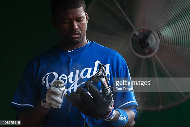 Wilson Betemit of the Kansas City Royals sprays his glove in the dugout during a game against the Washington Nationals at Nationals Park on June 23...