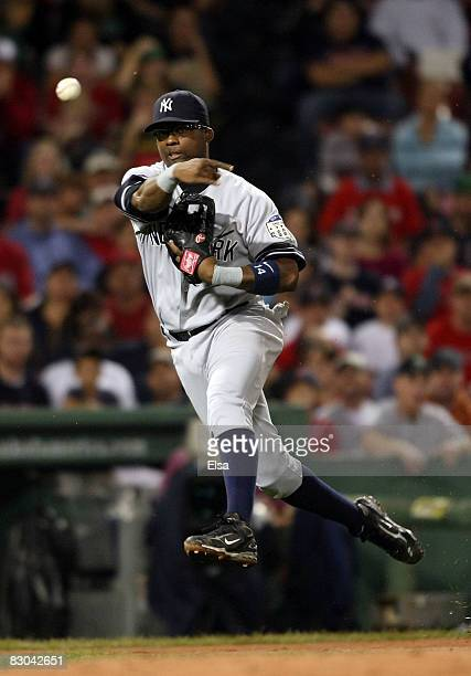 Wilson Betemit of the New York Yankees fields a hit by Gil Velazquez of the Boston Red Sox and sends it to first for the out in the second inning on...