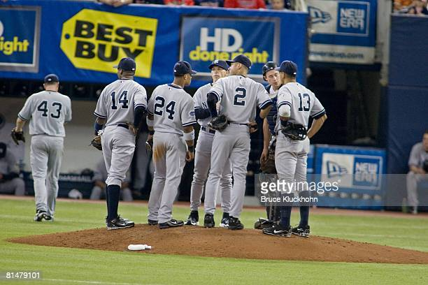 Wilson Betemit , Robinson Cano , Joe Girardi, Derek Jeter , Chad Moeller , and Alex Rodriguez of the New York Yankees meet at the mound during a...