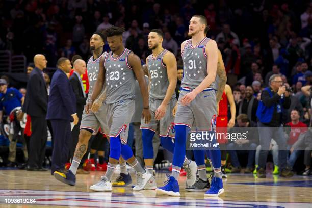 Wilson Chandler Jimmy Butler Ben Simmons and Mike Muscala of the Philadelphia 76ers walk off the court against the Atlanta Hawks at the Wells Fargo...