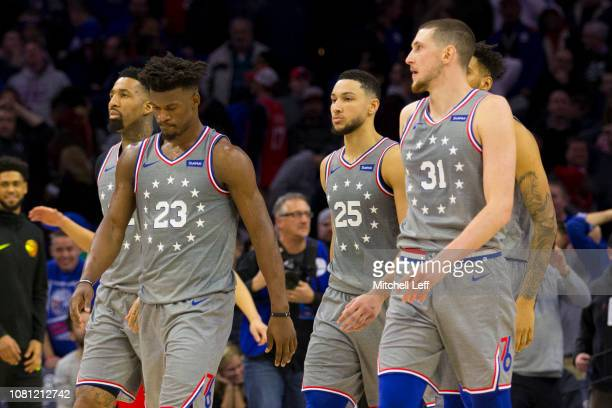 Wilson Chandler Jimmy Butler Ben Simmons Jonah Bolden and Mike Muscala of the Philadelphia 76ers walk off the court after the game against the...