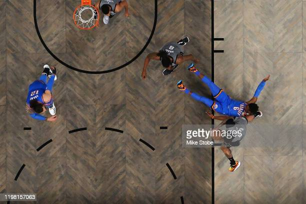 Wilson Chandler of the Brooklyn Nets and Hamidou Diallo of the Oklahoma City Thunder battle for the ball at Barclays Center on January 07 2020 in New...