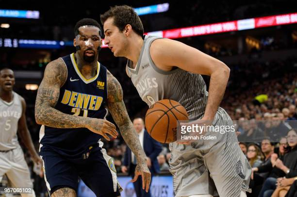 Wilson Chandler of the Denver Nuggets defends against Nemanja Bjelica of the Minnesota Timberwolves during the game on April 11 2018 at the Target...