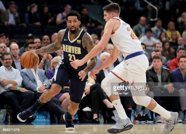 Wilson Chandler of the Denver Nuggets drives down the court against Damyean Dotson of the New York Knicks in the third quarter during their game at...