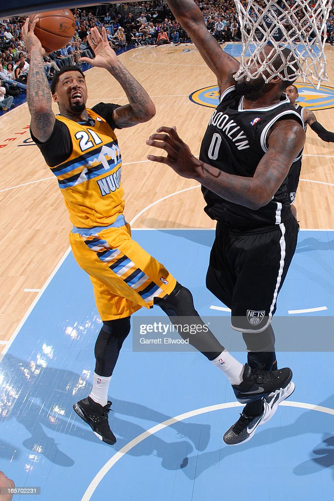 Wilson Chandler #21 of the Denver Nuggets drives to the basket against the Brooklyn Nets on March 29, 2013 at the Pepsi Center in Denver, Colorado.