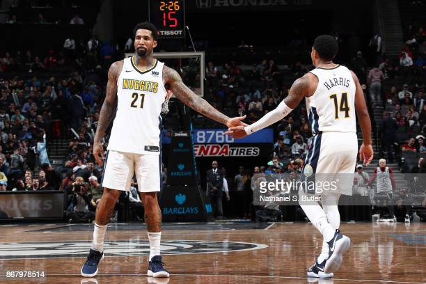 Wilson Chandler of the Denver Nuggets gives high five to Gary Harris of the Denver Nuggets during the game against the Brooklyn Nets on October 29...
