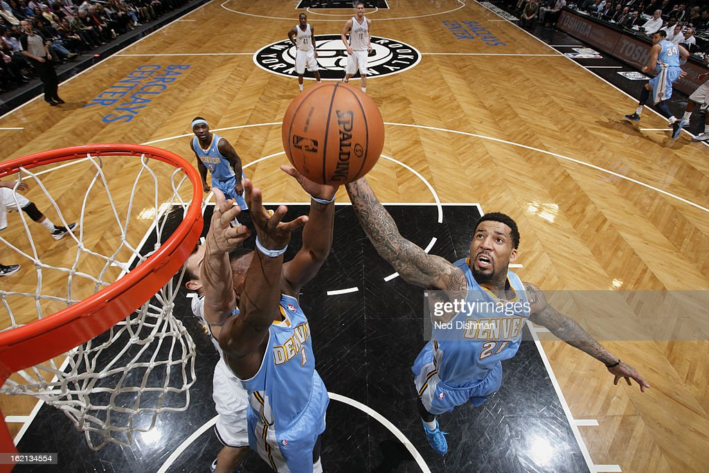 Wilson Chandler #21 of the Denver Nuggets grabs the rebound against the Brooklyn Nets on February 13, 2013 at the Barclays Center in the Brooklyn borough of New York City in New York City.