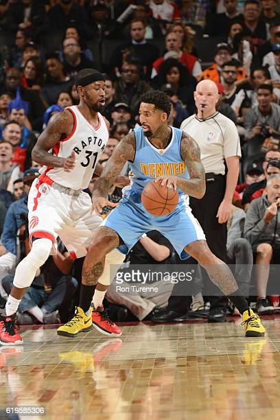 Wilson Chandler of the Denver Nuggets handles the ball against Terrence Ross of the Toronto Raptors during a game on October 31 2016 at the Air...