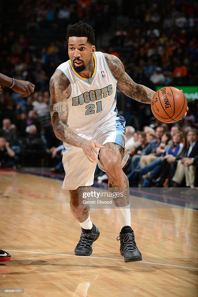 Wilson Chandler #21 of the Denver Nuggets handling the ball during a game against the Cleveland Cavaliers on January 17, 2014 at the Pepsi Center in Denver, Colorado.