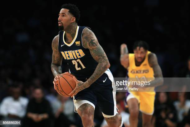 Wilson Chandler of the Denver Nuggets looks to pass as Brandon Ingram of the Los Angeles Lakers runs up court during the second half of a preseason...