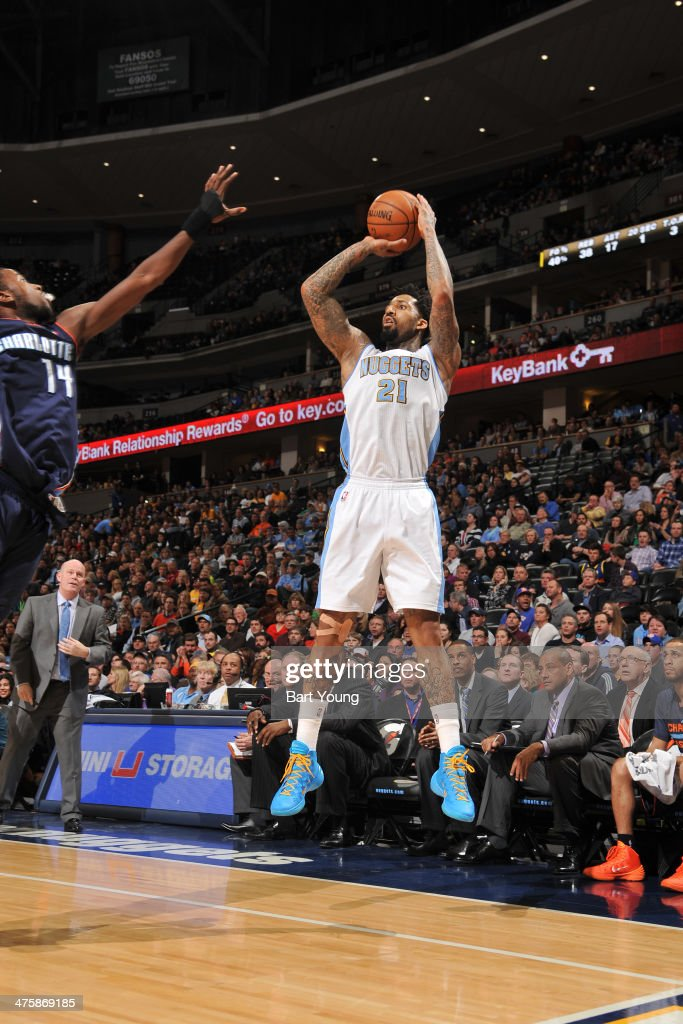 Wilson Chandler #21 of the Denver Nuggets shoots against the Charlotte Bobcats on January 29, 2014 at the Pepsi Center in Denver, Colorado.