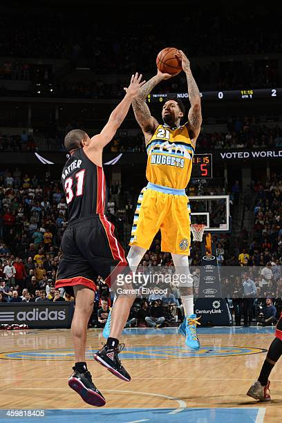Wilson Chandler of the Denver Nuggets shoots against the Miami Heat on December 30 2013 at the Pepsi Center in Denver Colorado NOTE TO USER User...