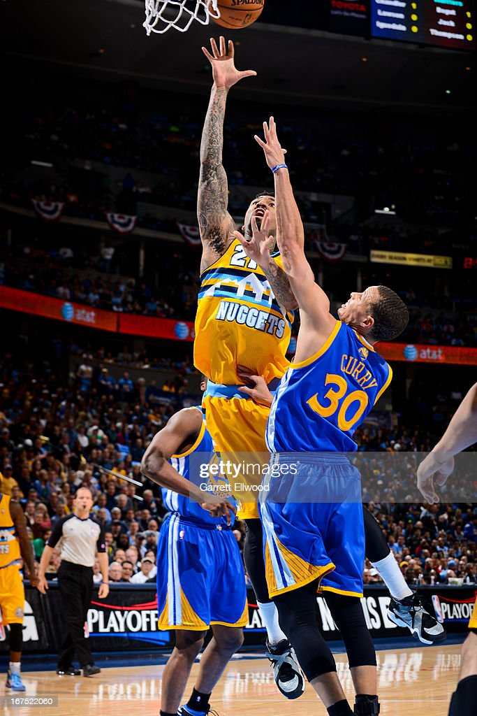Wilson Chandler #21 of the Denver Nuggets shoots in the lane against Stephen Curry #30 of the Golden State Warriors in Game Two of the Western Conference Quarterfinals during the 2013 NBA Playoffs on April 23, 2013 at the Pepsi Center in Denver, Colorado.