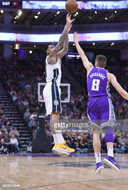 Wilson Chandler of the Denver Nuggets shoots over Bogdan Bogdanovic of the Sacramento Kings during an NBA Basketball game at Golden 1 Center on...
