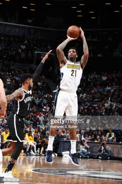 Wilson Chandler of the Denver Nuggets shoots the ball against the Brooklyn Nets on October 29 2017 at Barclays Center in Brooklyn New York NOTE TO...