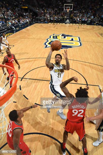 Wilson Chandler of the Denver Nuggets shoots the ball against the Toronto Raptors on November 1 2017 at the Pepsi Center in Denver Colorado NOTE TO...