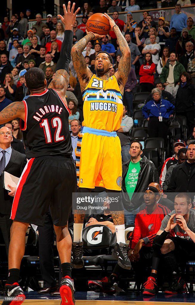 Wilson Chandler #21 of the Denver Nuggets sinks the game winning three point shot over LaMarcus Aldridge #12 of the Portland Trail Blazers in overtime at the Pepsi Center on January 15, 2013 in Denver, Colorado. The Nuggets defeated the Trail Blazers 115-111 in overtime.