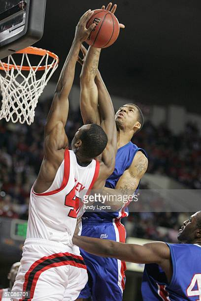 Wilson Chandler of the DePaul Blue Demons moves to block Terrance Farley of the Louisville Cardinals on Feburary 22 2006 at Freedom Hall in Loisville...