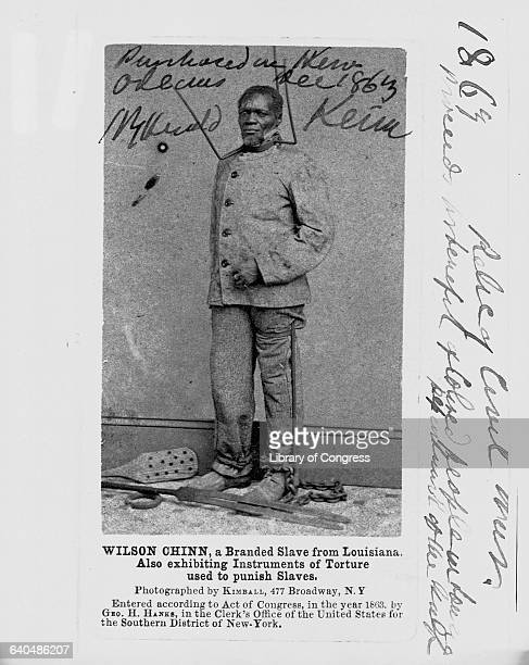 Wilson Chinn a branded slave from Lousiana exhibits torture implements used to punish slaves ca 1863
