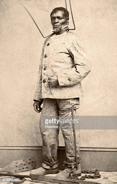 Wilson Chinn a freed slave from Louisiana poses with equipment used to punish slaves Such images were used to set Northern resolve against...
