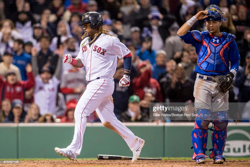 Wilson Contreras #40 of the Chicago Cubs reacts as Hanley Ramirez #13 of the Boston Red Sox scores during the eighth inning of a game on April 30, 2017 at Fenway Park in Boston, Massachusetts.