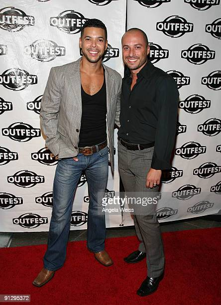 Wilson Cruz and Guillermo Bass arrive at Outfest's 2009 Legacy Awards at the DGA Theatre on September 30 2009 in West Hollywood California