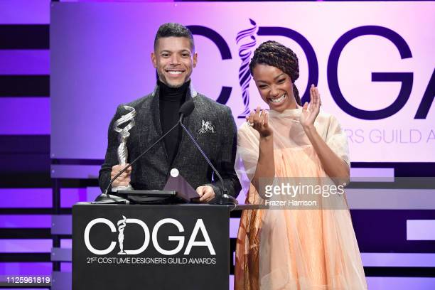 Wilson Cruz and Sonequa MartinGreen speak onstage during The 21st CDGA at The Beverly Hilton Hotel on February 19 2019 in Beverly Hills California