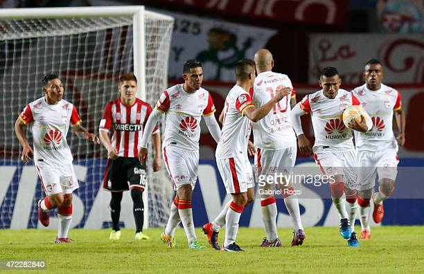 Wilson David Morelo of Independiente Santa Fe and teammates celebrate their team's first goal during a first leg match between Estudiantes and...