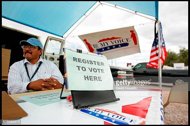 Wilson Deschine sits at the 'be my voice' voter registration stand at the Navajo Nation annual rodeo in Window Rock