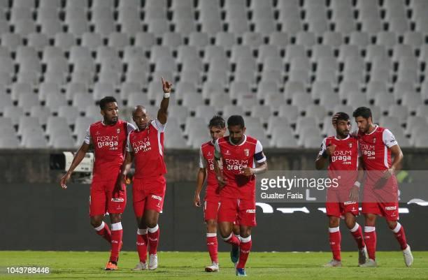 Wilson Eduardo of SC Braga celebrates with teammates after scoring a goal during the Liga NOS match between Belenenses SAD and SC Braga at Estadio...