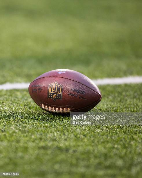 Wilson football with the NFL logo rests on the field during the game between the Buffalo Bills and the Dallas Cowboys on December 27 2015 at Ralph...