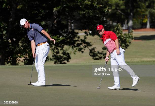 Wilson Furr of the Alabama Crimson Tide watches as Jovan Rebula of the Auburn Tigers reacts to his putt on the fifth green during day three of the...