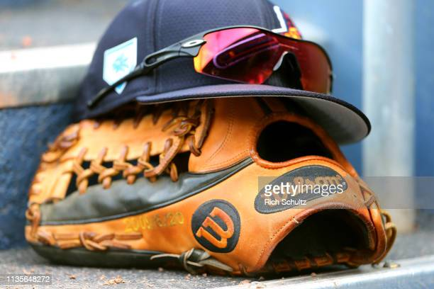 Wilson glove of the Atlanta Braves on the steps of the dugout during a spring training baseball game against the Washington Nationals at Fitteam...