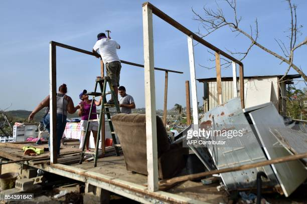 Wilson Hernandez and his family rebuild their house destroyed by Hurricane Maria in the neigborhood of Acerolas in Toa Alto Puerto Rico on September...