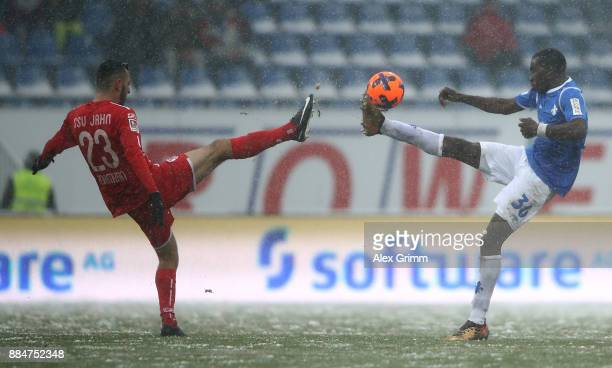 Wilson Kamavuaka of Darmstadt and Sargis Adamyan of Regensburg battle for the ball during the Second Bundesliga match between SV Darmstadt 98 and SSV...