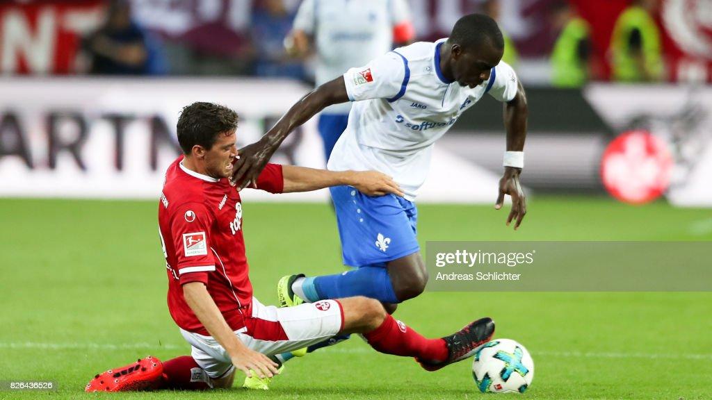Wilson Kamavuaka of Darmstadt challenges Benjamin Kessel of Kaiserslautern during the Second Bundesliga match between 1. FC Kaiserslautern and SV Darmstadt 98 at Fritz-Walter-Stadion on August 4, 2017 in Kaiserslautern, Germany.