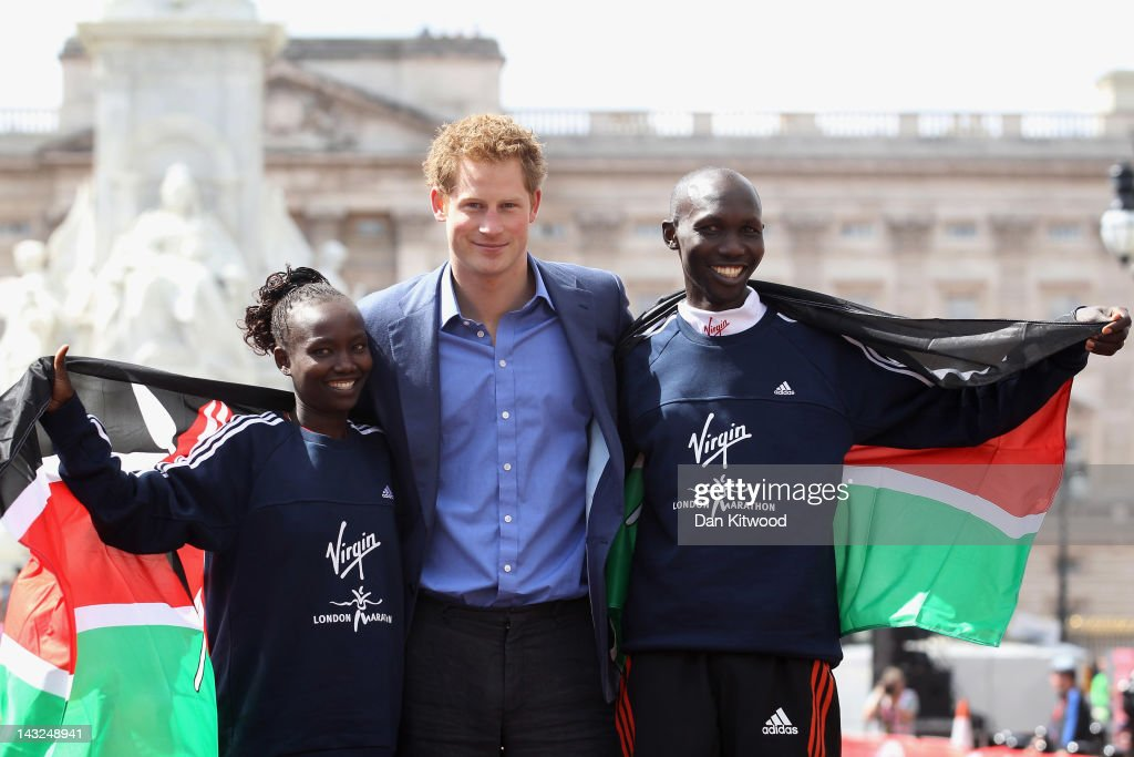 Wilson Kipsang and Mary Keitany of Kenya pose with Prince Harry after winning the men and women's Elite race during the Virgin London Marathon 2012 on April 22, 2012 in London, England.
