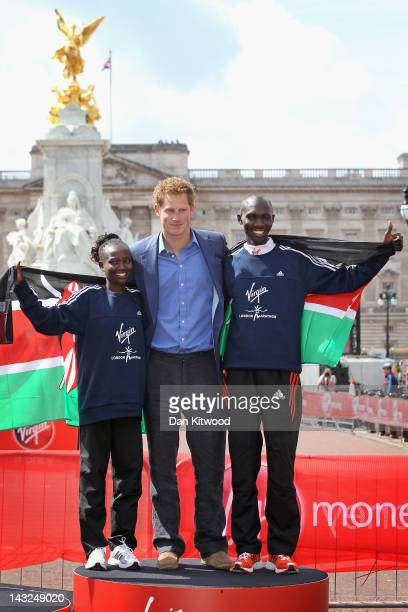 Wilson Kipsang and Mary Keitany of Kenya pose with Prince Harry after winning the men and women's Elite race during the Virgin London Marathon 2012...