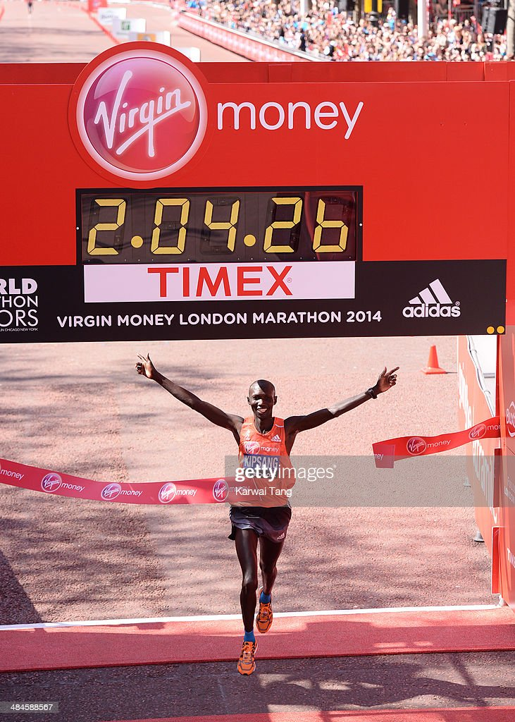 Wilson Kipsang crosses the finish line after winning the Men's Elite race at the Virgin London Marathon on April 13, 2014 in London, England.