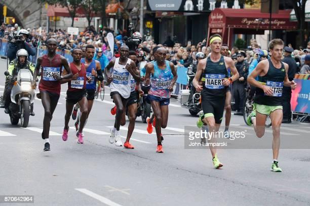 Wilson Kipsang Kiprotich, Geoffrey Kamworor, Abdihakem Abdirahman, Meb Keflezighi and Koen Naert seen running at mile 17 during the 2017 TCS New York...