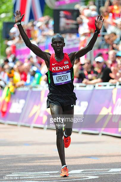 Wilson Kipsang Kiprotich of Kenya celebrates as he crosses the line to win bronze in the Men's Marathon on Day 16 of the London 2012 Olympic Games at...