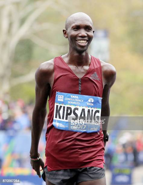 Wilson Kipsang of Kenya celebrates as he crosses the finish line in second place in the Professional Men's division during the TCS New York City...