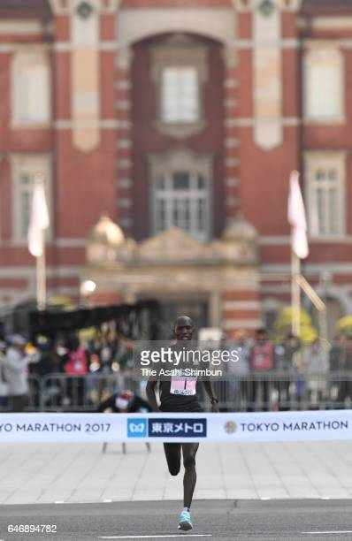 Wilson Kipsang of Kenya crosses the finish tape to win the Men's Marathon during the Tokyo Marathon 2017 on February 26 2017 in Tokyo Japan
