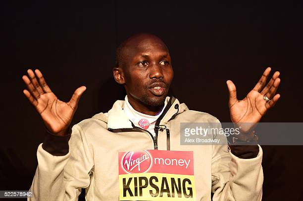Wilson Kipsang of Kenya speaks on stage with Tim Hutchings during the opening press conference ahead of Sunday's Virgin Money London Marathon at the...