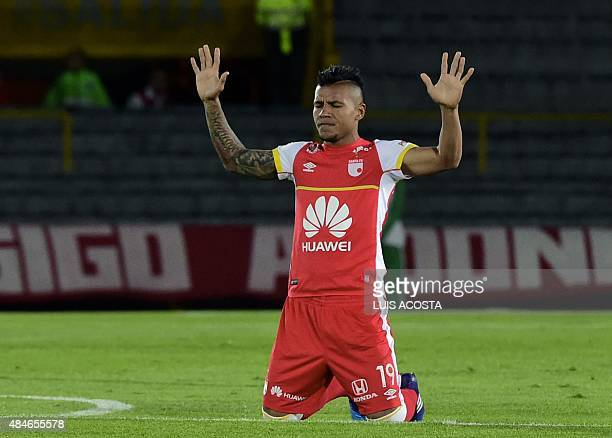Wilson Morelo of Colombia's Santa Fe prays before their 2015 Copa Sudamericana football match against Ecuador's Liga de Loja, at El Campin stadium,...