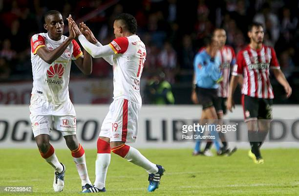Wilson Morelo of Independiente Santa Fe celebrates with Dairon Mosquera after scoring the first goal of his team during a first leg match between...
