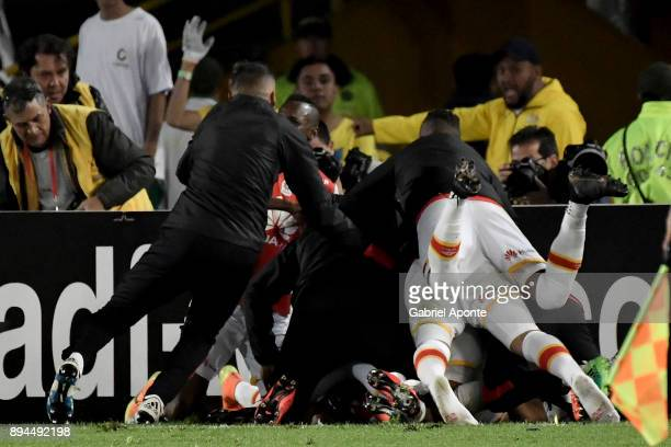 Wilson Morelo of Santa Fe celebrates with teammates after scoring the secong goal of his team during the second leg match between Millonarios and...